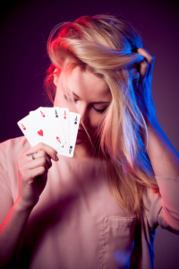 blond-girl-holding-gambling-cards